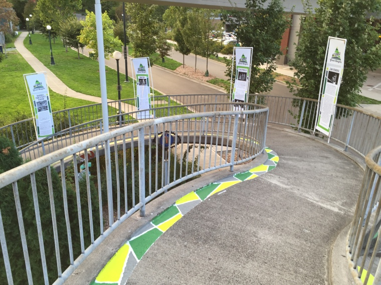 Painted ground and banners on bridge